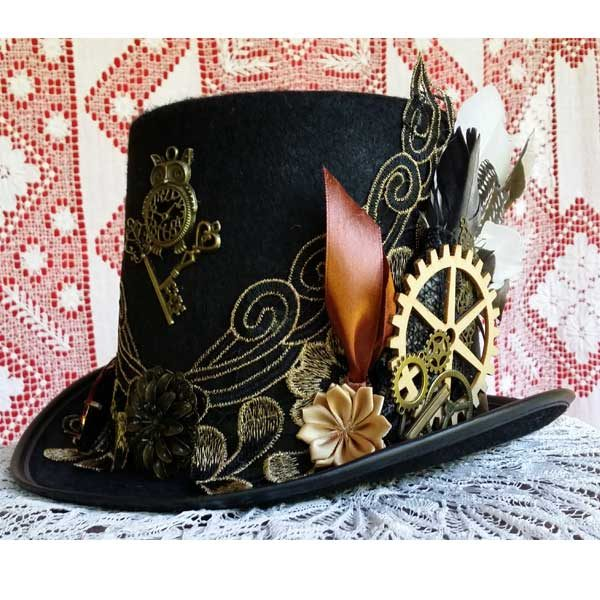 f4adedd93 Elegant black and gold lace top hat. Perfect for the mother of the bride.
